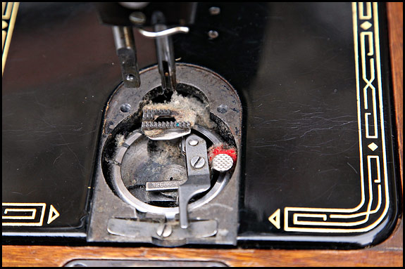 fluff under needle plate of Singer 99k sewing machine
