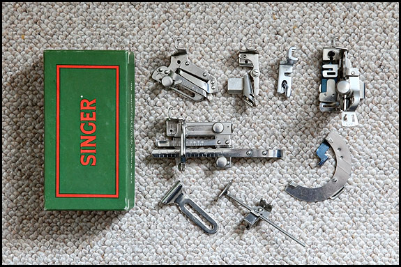 picture of Singer attachments and card box
