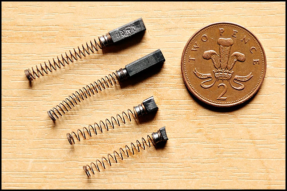 Picture of two pairs of Singer sewing machine motor brushes