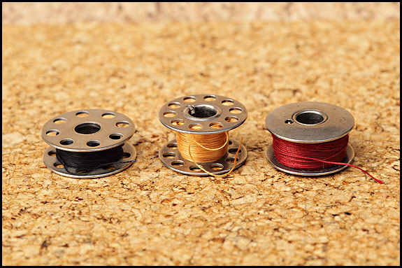 Picture of bobbins used in vinatge Singer sewing machines