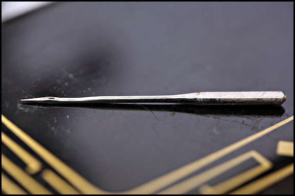 another picture of a sewing machine needle