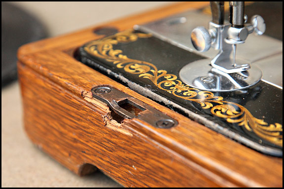 picture of damaged base of singer sewing machine