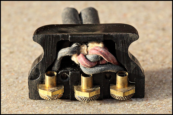 Photo of inside of vintage Singer sewing machine motor plug