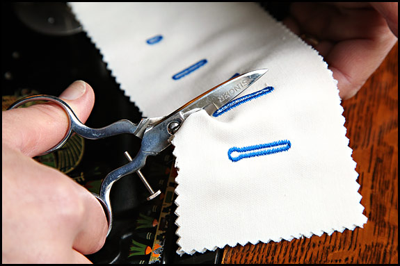 Picture of vintage Singer adjustable buttonhole scissors in use