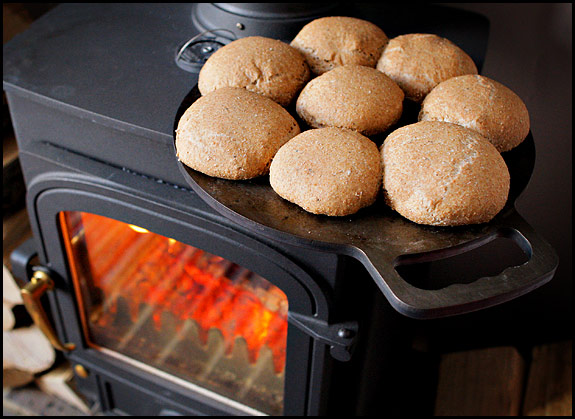 Picture of spelt buns cooking on top of woodstove
